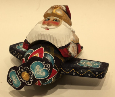 Hand Carved and Painted Santa Claus Flying on Airplane