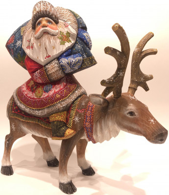 Hand Carved and Painted Santa Claus Rides a Deer
