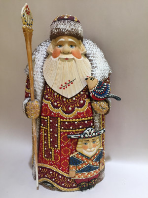 santa in a red coat with magic stick and nutcracker