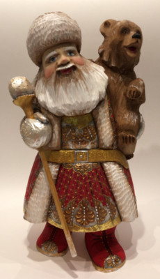 Hand Carved and Painted Santa Claus vs Bear