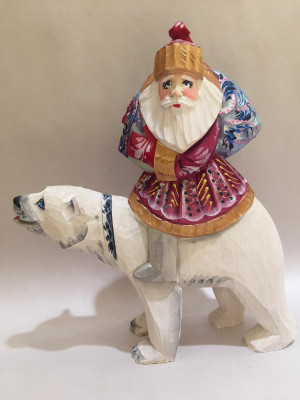 santa is riding a polar bear