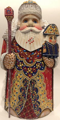 Hand Carved and Painted Santa with a Nutcracker