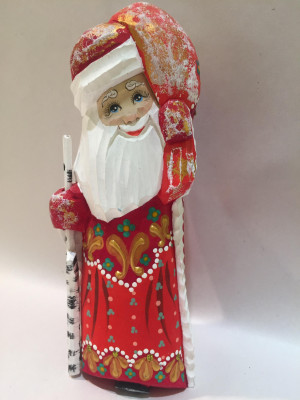 santa carries a bag with christmas gifts