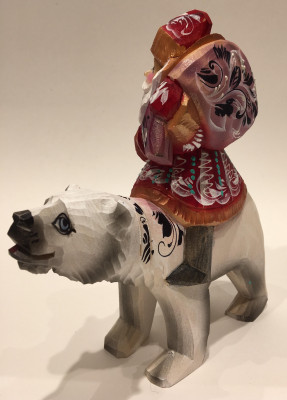 Hand Carved and Painted Santa Claus Riding Polar Bear
