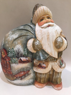 standing santa with a big bag