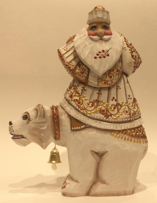 Hand Carved and Painted Santa rides Polar Bear